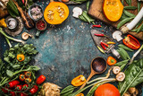 Healthy and organic harvest vegetables and ingredients: pumpkin, greens, tomatoes,kale,leek,chard,celery on rustic kitchen table background for tasty Thanksgiving seasonal cooking, frame, top view - 149667574