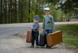 Two boys go on the road with big suitcases