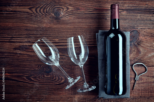 Bottle of red wine and two glasses Poster