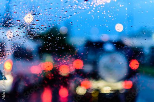 Foto op Aluminium Nacht snelweg Defocused blur of light on the road in a raining day