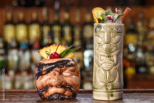 Poster selection of tropical cocktail in tiki glass