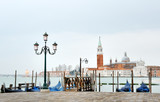 Venice, Italy, Europe - picturesque view of gondolas and lamp