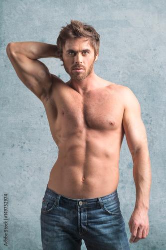 Sexy guy posing in studio