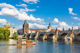 Prague, Czech Republic, Charles Bridge across Vltava river on which the ship sails