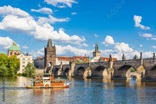 Papiers peints Prague Prague, Czech Republic, Charles Bridge across Vltava river on which the ship sails
