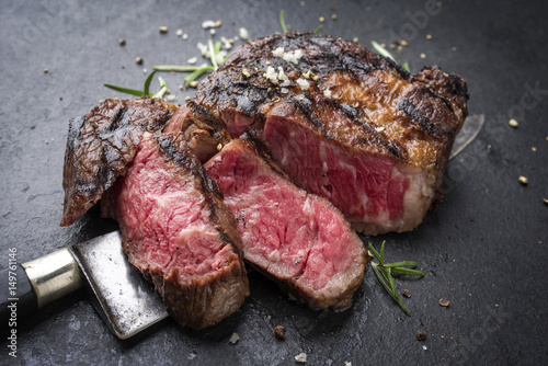 Plexiglas Steakhouse Barbecue aged Wagyu Rib Eye Steak as close-up on slate