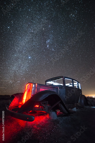 Fotobehang Route 66 Rusty, Abandoned Car on Route 66 Under Winter Night Sky, Petrified Forest National Park, Arizona