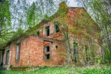 Old abandoned factory building in the forest in Moscow region, Russia