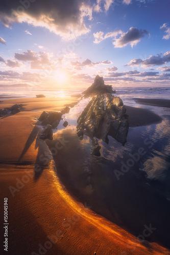 rock in Sopelana beach at sunset