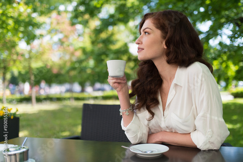 Woman drinking from a cup