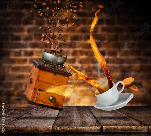 Porcelaine white cup with splashing coffee and grinder, blur grunge wall on background