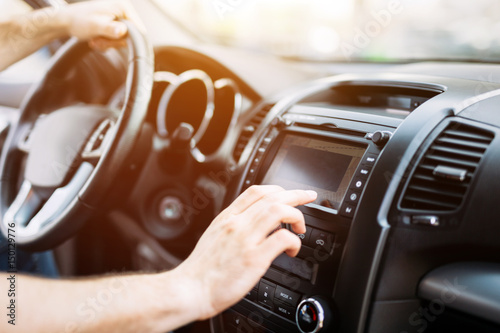 Foto op Canvas Snelle auto s Man using navigation system while driving car