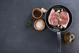 Sirloin chop in frying pan with ingredients - 150153967