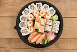 Various sushi rolls in platter