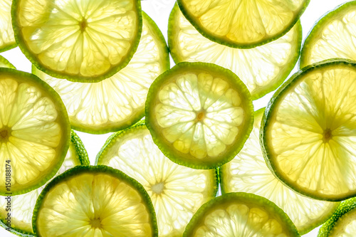 Bright lime slices on white