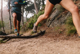 Runner legs running on mountain trail