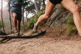 Runner legs running on mountain trail - 150214947