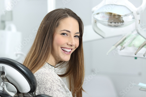Dentist patient showing perfect smile after treatment