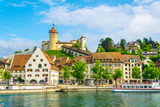 Fototapety The munot fortress in the swiss city schaffhausen is reflected on the rhine river in summer.