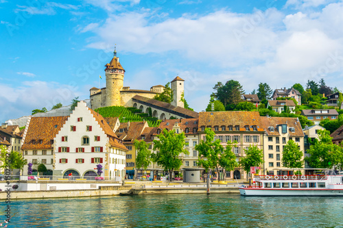 The munot fortress in the swiss city schaffhausen is reflected on the rhine river in summer. - 150236712