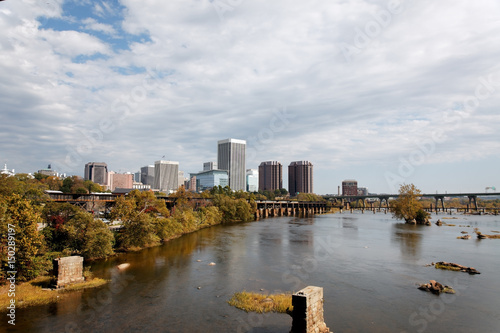 Richmond, Virginia skyline with the James River in foreground.