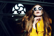 Close up indoor portrait of young beautiful fashionable woman with long hair. wearing stylish round sunglasses, yellow blouse. Model looking up. Female fashion concept. Copy, empty space for text