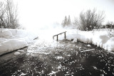 Frozen pond in the ice