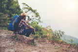 Young hipster Hiker with backpack sitting on top of the mountain. - 150449971