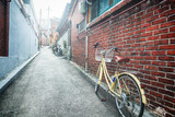 bicycle leaning against the wall on the background of the street