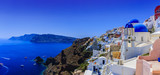 Picturesque view of Old Town Oia on the island Santorini, white houses, windmills and church with blue domes, Greece - 150487590