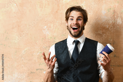 morning coffee, young happy business man holding paper cup Poster