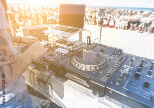 Dj mixing outdoor in after disco party on the beach party Poster