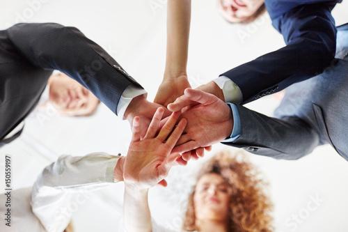 Gruppe Geschäftsleute stapelt Hände Poster