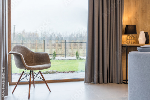 Chair in room with window - 150580755