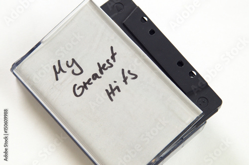 My greatest Hits in handwriting written on music cassette tape case