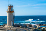 Landscape View of Lighthouse Against Sea and Clear Sky