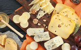 Beautiful composition with variety of cheese on wooden table
