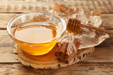 Cinnamon and honey in bowl on wooden background