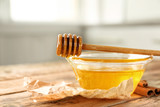 Cinnamon and honey in glass bowl on table