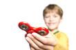Boy holding popular fidget spinner toy on a white background.