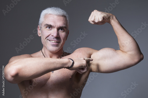 Strong Man Fitness Model Torso showing flexing bicep muscle (Healthy lifestyle, sports, fitness, strength, beauty)