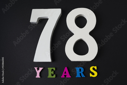 Poster Letters and numbers seventy-eight years old on a black background