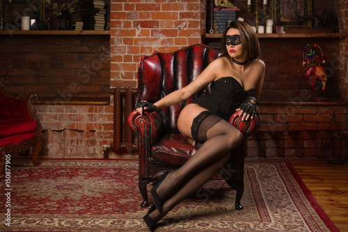 Beautiful dominant brunette mistress girl in black lingerie Poster