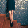 fashion girl in little black dress and high heel shoes