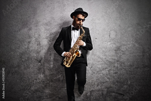 Poster Jazz musician playing saxophone against rusty gray wall