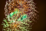 Fantastic abstract flowers of fireworks against a dark night sky
