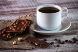 coffee chocolate cinnamon on a wooden background