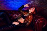 girl smokes a cigar