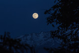 Moon rising in the mountains
