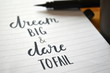 DREAM BIG & DARE TO FAIL motivational quote written in notebook